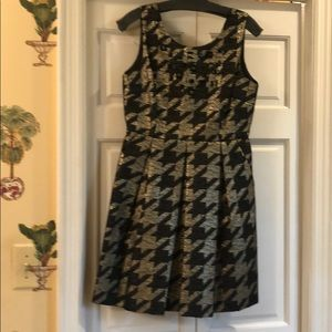 Metallic gold and black herringbone party dress.